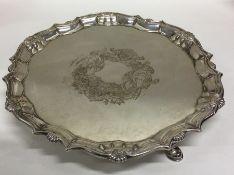 A Georgian silver circular salver attractively dec