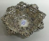 A circular chased silver bonbon dish. Birmingham 1