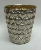 An unusual cast silver tapering beaker of heart sh