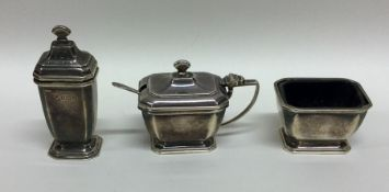 An Art Deco silver three piece cruet set. Birmingh