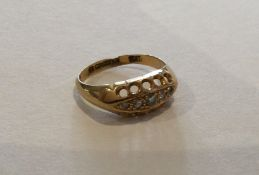 A diamond five stone boat shaped ring set in 18 ca