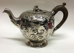 A good Georgian silver bullet shaped teapot profus