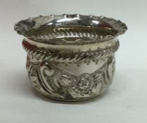 A Victorian silver chased bowl with crimped rim. L
