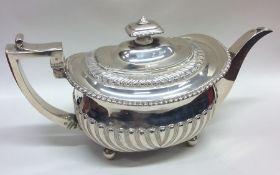 A good Georgian half fluted silver teapot on ball