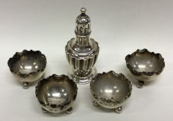 A set of four Edwardian silver salts with crimped