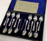 A fine cased set of twelve silver teaspoons togeth