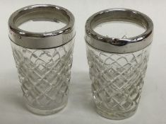 A pair of silver mounted and glass tapering beaker
