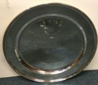 A massive circular Russian silver charger with ree