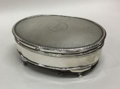 An engine turned silver hinged top jewellery box.