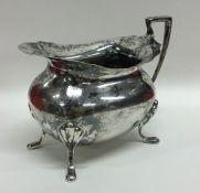 A heavy Edwardian silver cream jug. Sheffield 1901