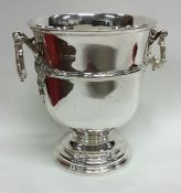 An Edwardian silver two handled ice bucket on swee