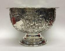 A large Edwardian silver embossed rose bowl decora