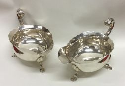 A good pair of George II silver sauce boats with c