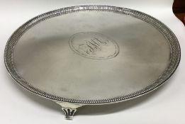 A good George III circular silver salver with flut