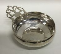 An early 18th century silver bleeding bowl with pi