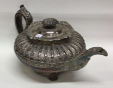A good Georgian silver teapot of half fluted desig