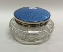 A silver and enamelled dressing table jar. Birming
