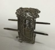 A silver filigree model of a carriage. Approx. 15