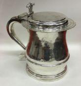 A heavy Georgian style silver tankard with flat li