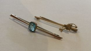Two gold gem set brooches. Approx. 4 grams. Est. £