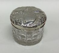 A heavy silver and cut glass dressing table jar de
