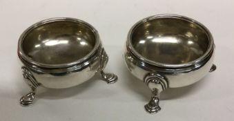 A pair of circular silver Georgian salts with reed