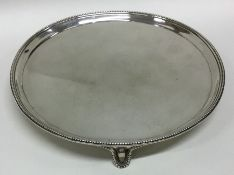 A good George III circular silver waiter with bead