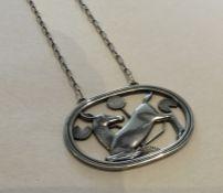 GEORG JENSEN: A stylish oval Danish silver pendant
