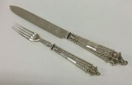 A heavy Victorian silver serving knife and fork wi