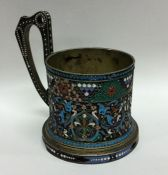 A Russian silver gilt and enamelled tea glass hold