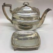 A good Georgian bright cut silver teapot on matchi