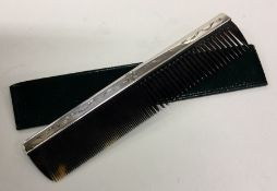 A large silver and tortoiseshell comb engraved wit