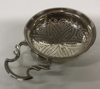 A Georgian silver lemon strainer. London. By GV. A
