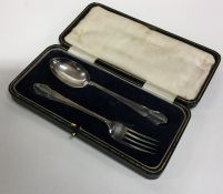 An Edwardian silver two piece christening set. She