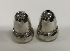 A pair of miniature silver peppers. Birmingham 192