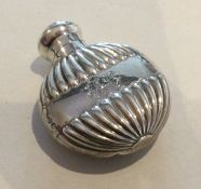 A small Edwardian silver half fluted scent bottle.