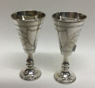 A matched pair of heavy silver Kiddush cups. Chest