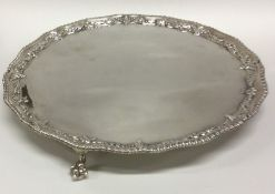 A fine circular silver salver with gadroon rim and