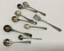 A bag containing miniature silver salt spoons. Var