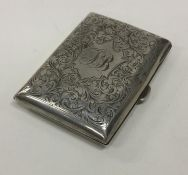 An Edwardian silver cigarette case decorated with
