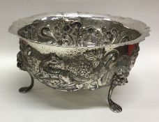 A large circular silver bowl of Irish design embos