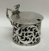 A finely pierced silver mustard pot with engraved