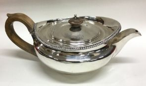 A heavy fine quality George III silver teapot with