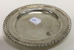 PAUL STORR: A circular silver teapot stand with ga