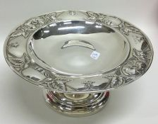An Art Nouveau silver sweet dish on sweeping pedes