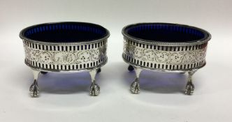 A pair of oval George III silver salts decorated w