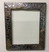A large rectangular silver picture frame of stylis