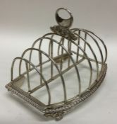 A large seven bar silver toast rack with three scr