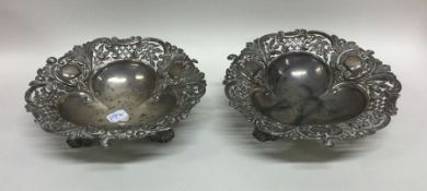 A pair of unusual silver pierced bonbon dishes of