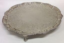 A good Georgian circular silver salver engraved wi
